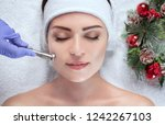 the cosmetologist makes the... | Shutterstock . vector #1242267103
