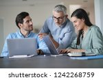young colleagues with older... | Shutterstock . vector #1242268759