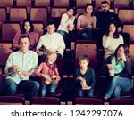 group of people eating popcorn... | Shutterstock . vector #1242297076