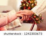 elderly woman celebrating... | Shutterstock . vector #1242303673
