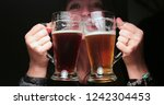 woman drinking beer from two... | Shutterstock . vector #1242304453