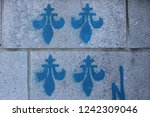 The Fleur De Lys Spray Painted...