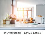 served table for breakfast with ... | Shutterstock . vector #1242312583