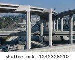 a complex freeway interchange... | Shutterstock . vector #1242328210