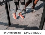 competitive couple. legs of a... | Shutterstock . vector #1242348370