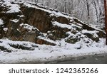 Snow Covered Rocks And Trees
