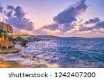 the stormy weather after sunset ... | Shutterstock . vector #1242407200
