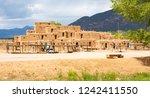 taos pueblo national historical ... | Shutterstock . vector #1242411550