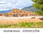 taos pueblo national historical ... | Shutterstock . vector #1242411556