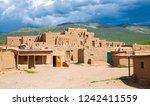 taos pueblo national historical ... | Shutterstock . vector #1242411559