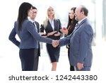 handshake of a businessman and... | Shutterstock . vector #1242443380
