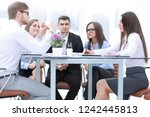 business team working on a new... | Shutterstock . vector #1242445813
