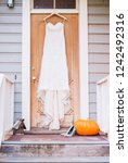 bridal gown hanging on the... | Shutterstock . vector #1242492316
