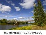 bridge over the river upper... | Shutterstock . vector #1242496990