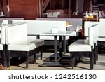 a wooden white table with white ... | Shutterstock . vector #1242516130