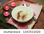 on a wooden tray are red... | Shutterstock . vector #1242521020