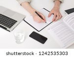 close up of young man hands... | Shutterstock . vector #1242535303
