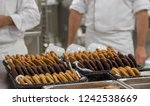 chef finishing baked cookies in ...   Shutterstock . vector #1242538669