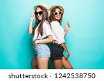 two lovely multiethnic women...   Shutterstock . vector #1242538750