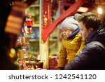 little boy and his father... | Shutterstock . vector #1242541120