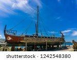 historical wooden shipwreck... | Shutterstock . vector #1242548380