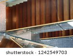 glass balustrades and two... | Shutterstock . vector #1242549703