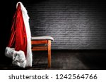 santa's clothes on a chair...   Shutterstock . vector #1242564766