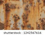dark worn rusty metal texture... | Shutterstock . vector #1242567616