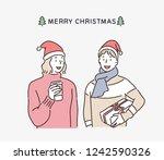 two men wearing christmas hats. ... | Shutterstock .eps vector #1242590326