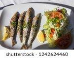 sardines  fish restaurant in... | Shutterstock . vector #1242624460