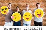 happy people holding positive...   Shutterstock . vector #1242631753