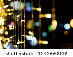 golden bokeh in the dark  ... | Shutterstock . vector #1242660049