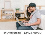 happy asian couple planning and ... | Shutterstock . vector #1242670930