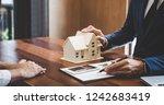 real estate broker agent... | Shutterstock . vector #1242683419