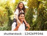 indian little girl sitting on...   Shutterstock . vector #1242699346