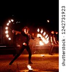 Small photo of Krasnodar, Russia-June 7, 2015. dancing with flame, master fakir with fire works, performance outdoors.