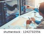 developing programmer team... | Shutterstock . vector #1242732556