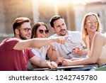group of four friends having... | Shutterstock . vector #1242745780