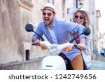 handsome guy and young woman on ... | Shutterstock . vector #1242749656