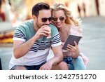 young couple drinking coffee... | Shutterstock . vector #1242751270