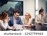 business team working together... | Shutterstock . vector #1242759463