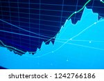 stock market trading graph and... | Shutterstock . vector #1242766186