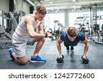young fit men in gym doing push ... | Shutterstock . vector #1242772600