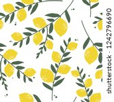 fresh lemons  leaves background.... | Shutterstock .eps vector #1242796690