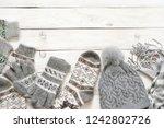 warm grey woolen knitwear ... | Shutterstock . vector #1242802726