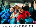 happy kids travel by car ... | Shutterstock . vector #1242811729