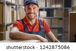 smiling worker sitting at his... | Shutterstock . vector #1242875086