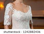 beautiful white wedding dress... | Shutterstock . vector #1242882436