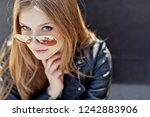 beautiful woman in the city  | Shutterstock . vector #1242883906