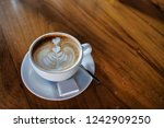 coffee cup on the wooden table. ...   Shutterstock . vector #1242909250